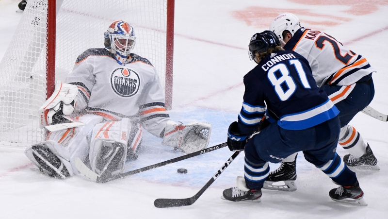 Edmonton Oilers goaltender Mikko Koskinen (19) makes a save as Winnipeg Jets' Kyle Connor (81) looks for the rebound during third period NHL action in Winnipeg on Tuesday Jan. 26, 2021. THE CANADIAN PRESS/Fred Greenslade