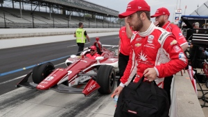 Ed Jones, of United Arab Emirates, carries his gear as the team leaves the pit area during practice for the Indianapolis 500 IndyCar auto race at Indianapolis Motor Speedway, Thursday, May 16, 2019 in Indianapolis. (AP Photo/Michael Conroy)