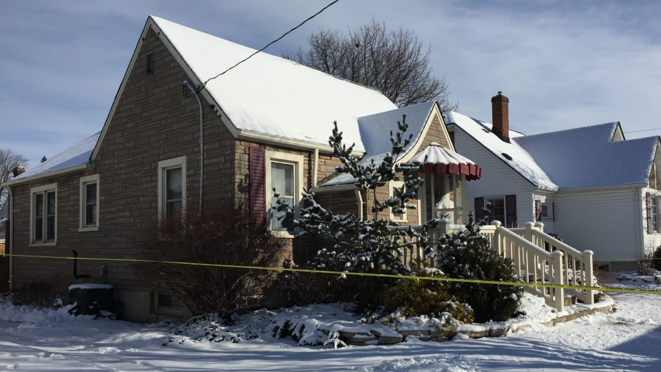 Police investigators work at the scene of a homicide at 566 Devine Street in Sarnia, Ont. on Wednesday, Jan. 27, 2021. (Bryan Bicknell / CTV News)