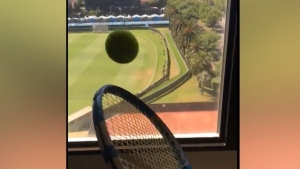 International champ Edouard Vasselin, isolating in a Melbourne hotel, combines tennis and dominoes to get through the days.