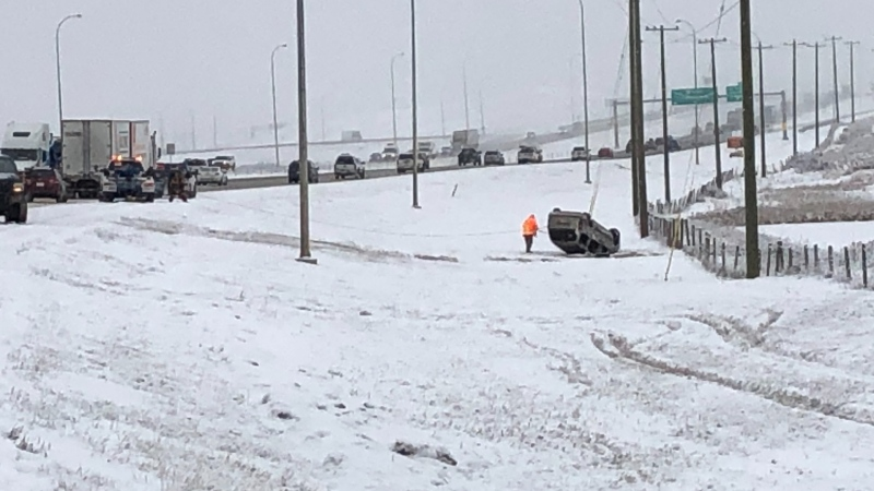 An overturned SUV in the ditch along the northbound lanes of Deerfoot Trail, approaching the Airport Trail exit, on Wednesday morning.