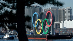 The Olympic Symbol is transported on a barge in the Odaiba section, in Tokyo. (AP Photo/Eugene Hoshiko, File)