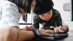 With screen time increasing for children during the pandemic, experts say parents should be more concerned with for what purpose their children are using their screens than for how long. (Alex Green / Pexels)
