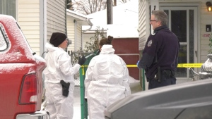 Officers at a home near 129 Street and 128 Avenue that was the scene of a fatal assault Jan. 23, 2020. (CTV News Edmonton)