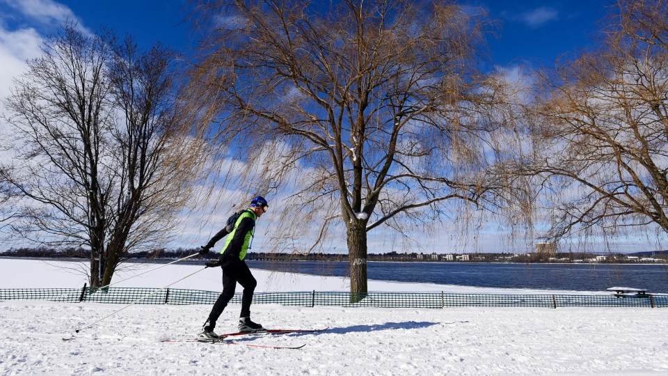 A skier makes his way along the banks of the Ottawa River in Ottawa on Wednesday, Jan. 27, 2021. (Sean Kilpatrick/THE CANADIAN PRESS)