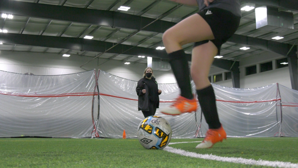 Faith Jasper, a participant in Sask Soccer's Female Coach Mentorship Program, trains players during a session at the Queen City Soccer Facility (Claire Hanna / CTV NEWS)