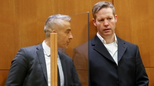 Main defendant Stephan Ernst, right, talks to his his lawyer Mustafa Kaplan, left, in the courtroom at the higher regional court in Frankfurt, Germany, Thursday, Jan. 28, 2021. (Kai Pfaffenbach/Pool Photo via AP)