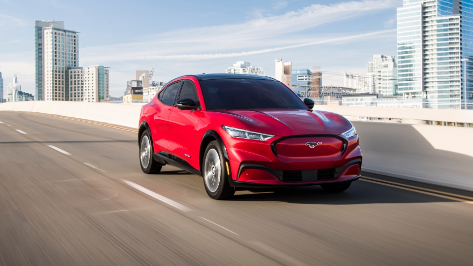 This photo provided by Ford shows the 2021 Ford Mustang Mach-E, an all-new compact electric compact SUV. (James Lipman /Ford Motor Co. via AP)