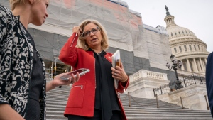 Republican Conference chair Rep. Liz Cheney, R-Wyo., speaks with reporters as lawmakers leave the Capitol in Washington, Friday, Jan. 10, 2020. (AP Photo/J. Scott Applewhite)