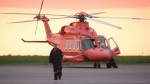 An Ornge air ambulance helicopter is secured on the tarmac in Kingston, Ont. on Monday June 9, 2014. THE CANADIAN PRESS/Colin Perkel