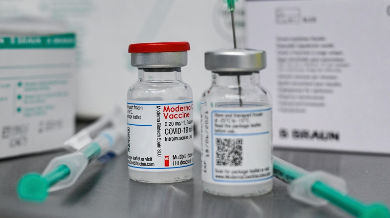 Small bottles containing Moderna's active ingredient for a Corona vaccination are pictured at the vaccination centre in Eberswalde, Germany, Wednesday, Jan. 27, 2021. (Patrick Pleul/dpa via AP)