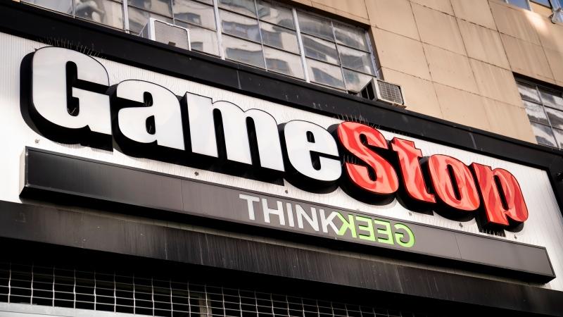 Pedestrians pass a GameStop store on 14th Street at Union Square, Thursday, Jan. 28, 2021, in the Manhattan borough of New York. (AP Photo/John Minchillo)
