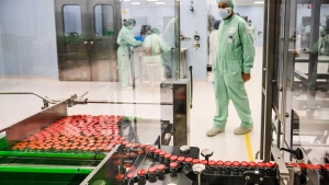 A laboratory technician supervises capped vials during filling and packaging tests for the large-scale production and supply of the University of Oxfords COVID-19 vaccine candidate, AZD1222, conducted on a high-performance aseptic vial filling line on September 11, 2020 at the Italian biologics manufacturing facility of multinational corporation Catalent in Anagni, southeast of Rome, during the COVID-19 infection, caused by the novel coronavirus. 9Vincenzo Pinto/AFP/Getty Images via CNN)