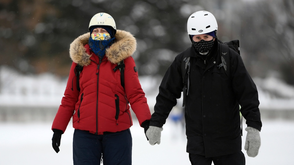 Wearning masks along Rideau Canal Skateway