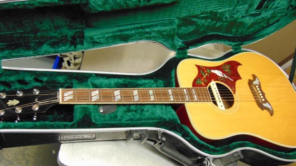 54-40 stolen guitar found