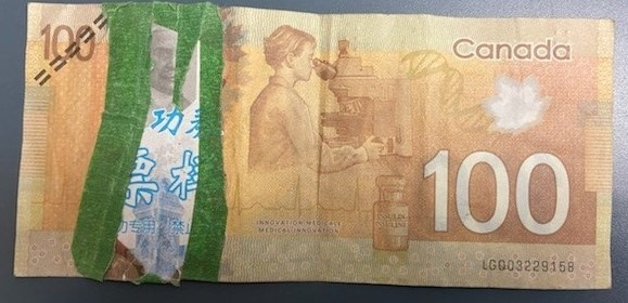 A 21-year-old woman from West Amherst, N.S. has been arrested for paying with counterfeit $100 bills in the Amherst area. (Photo via N.S. RCMP)