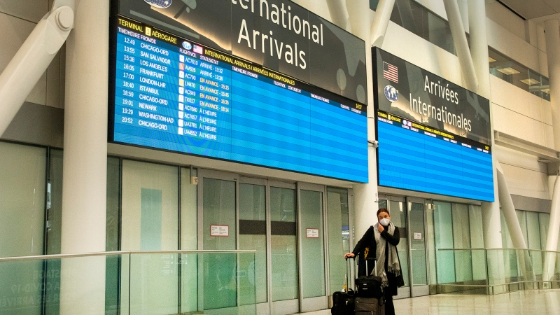 A lone passenger stands outside the International Arrivals area at Pearson Airport in Toronto on Tuesday January 26, 2021. THE CANADIAN PRESS/Frank Gunn