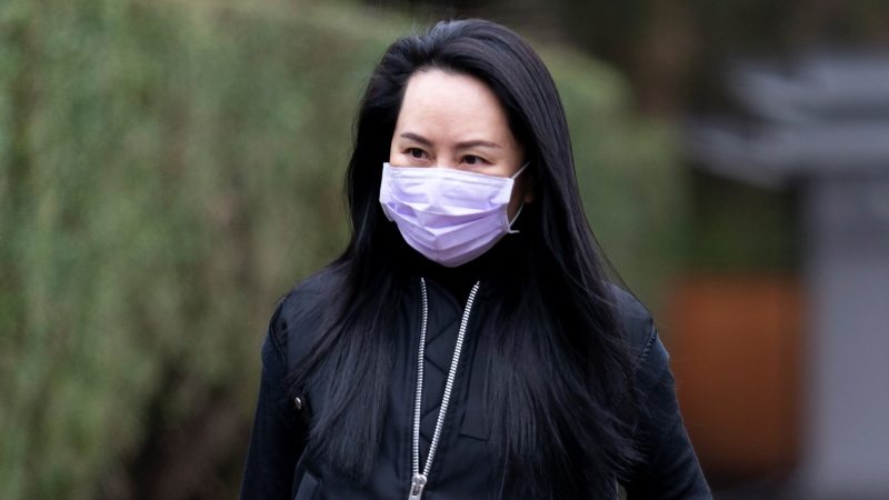 Chief Financial Officer of Huawei Meng Wanzhou leaves her home in Vancouver, to go to the British Columbia Supreme Court, Friday, Jan. 29, 2021. (Jonathan Hayward / THE CANADIAN PRESS)
