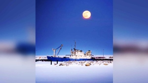Beautiful wolf moon over Gimli. Photo by Moe Soldier.