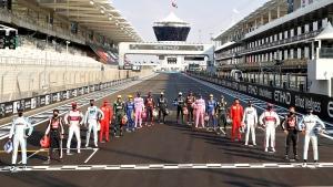 F1 drivers pose for a photo ahead of the Formula One race in the Yas Marina racetrack in Abu Dhabi, United Arab Emirates, Sunday, Dec.13, 2020. (Brynn Lennon, Pool via AP)