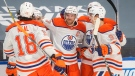 Edmonton Oilers' Connor McDavid (97) celebrates his goal against the Toronto Maple Leafs with teammates during second period NHL action in Edmonton on Saturday, January 30, 2021. THE CANADIAN PRESS/Jason Franson
