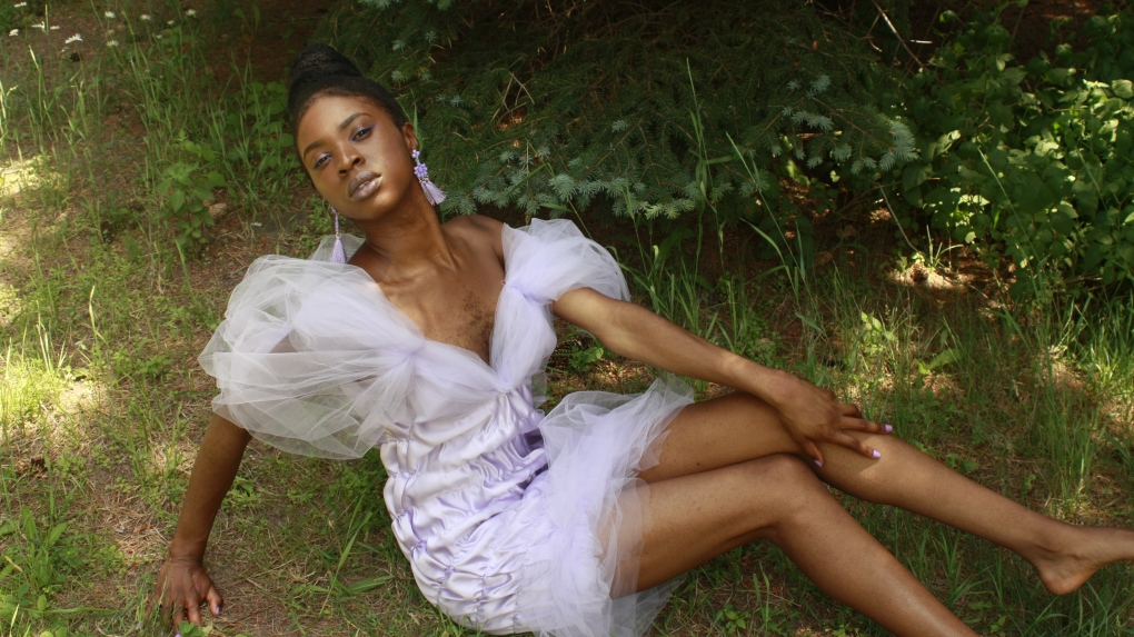 Esther Calixte-Bea poses in the Lavender Project