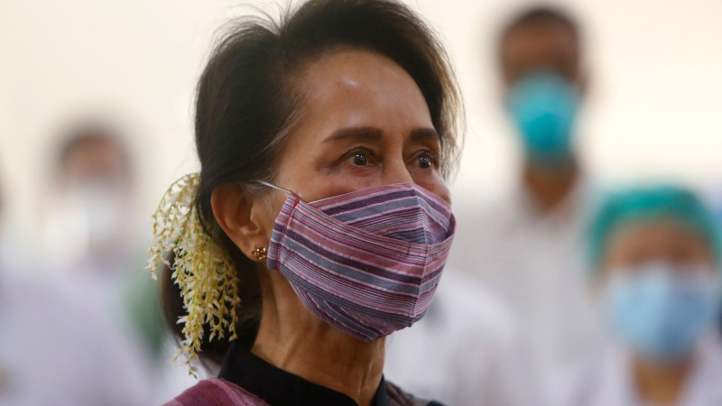 FILE - In this Jan 27, 2021, file photo, Myanmar leader Aung San Suu Kyi watches the vaccination of health workers at hospital in Naypyitaw, Myanmar. (AP Photo/Aung Shine Oo, File)