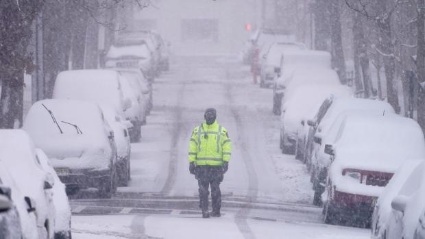 A traffic officer patrols a lightly trafficked street in Weehawken, N.J., Monday, Feb. 1, 2021. (AP Photo/Seth Wenig)