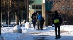 High school students arrive for school in Ottawa as in-person classes resume in the region for the first time since the winter holidays, on Monday, Feb. 1, 2021, in the midst of the COVID-19 pandemic. (Justin Tang/THE CANADIAN PRESS)