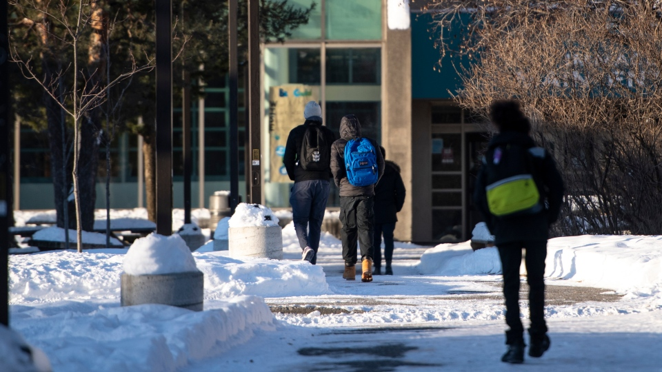 High school students arrive for school