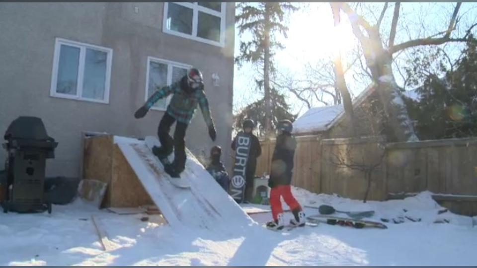 The backyard snowboard park.