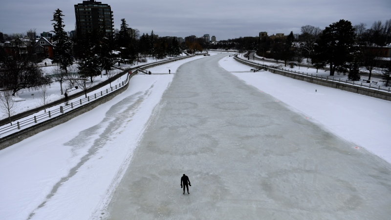 A person makes their way along the Rideau Canal Skateway on its opening day in Ottawa, on Thursday, Jan. 28, 2021, in the midst of the COVID-19 pandemic. The Rideau Canal is a UNESCO World Heritage Site. (Justin Tang/THE CANADIAN PRESS)
