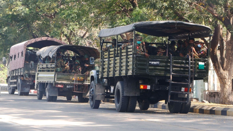 Soldiers sit inside trucks parked on a road in Naypyitaw, Myanmar, Monday, Feb. 1, 2021. (AP)