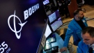 The Boeing logo appears above a trading post on the floor of the New York Stock Exchange, Thursday, March 12, 2020. (AP Photo/Richard Drew)