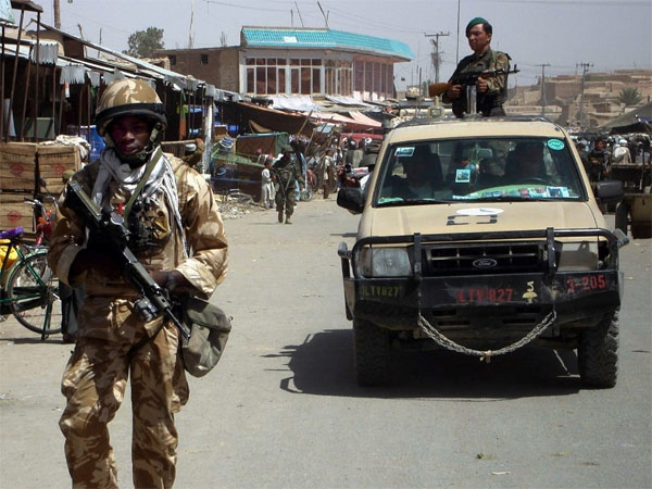 A Britain soldier part of the NATO forces patrols in the city of Gereshk district of Helmand province, south of Kabul, Afghanistan on Aug. 16, 2007. (AP / Abdul Khaleq)