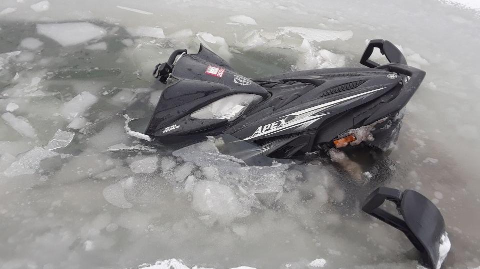 Snowmobile through the ice