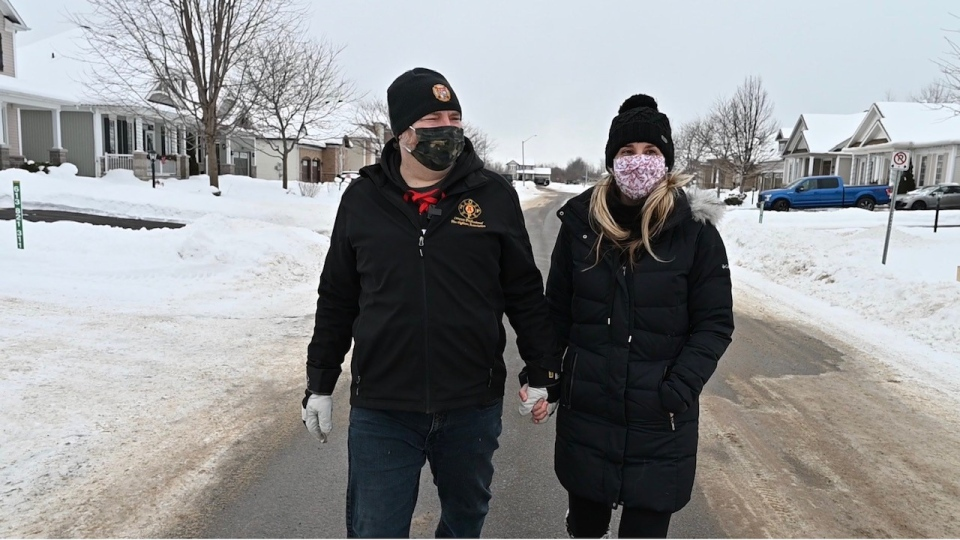 Ottawa firefighter Derek Bowker walking with his wife Jennifer Eberts. (Joel Haslam/CTV News Ottawa)