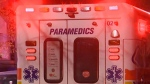 Simcoe County paramedics treat a victim of a serious assault and robbery in Orillia, Ont. on Mon. May 10, 2021 (FILE IMAGE)