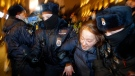 In this Tuesday, Feb. 2, 2021 file photo, police officers detain a Navalny supporter during a protest in St. Petersburg, Russia. (AP Photo/Dmitri Lovetsky, File)