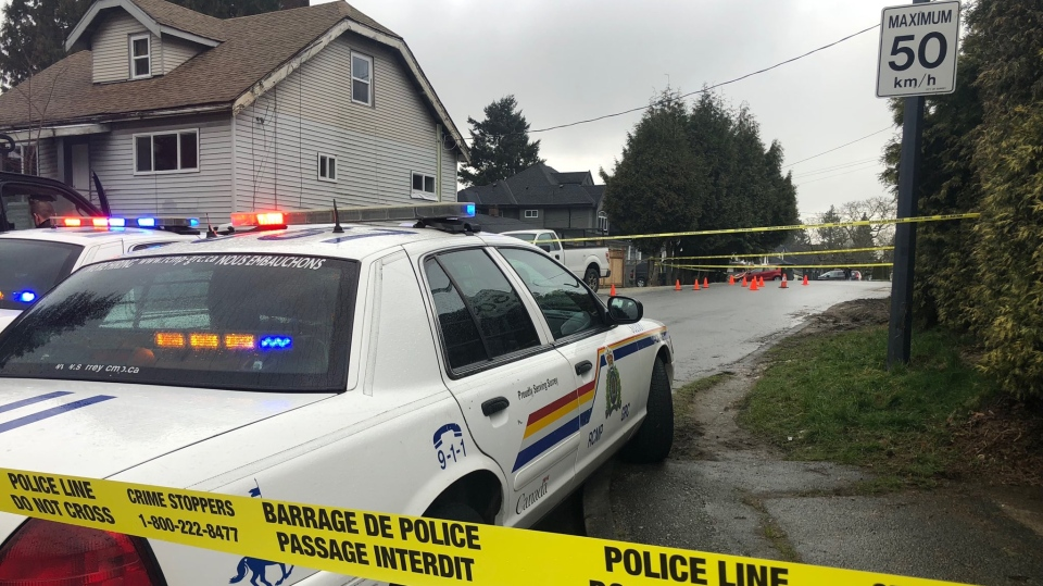 Police tape blocks the scene of a shooting in Surrey, B.C., on Thursday, Feb. 4, 2021. (Michele Brunoro / CTV News Vancouver)