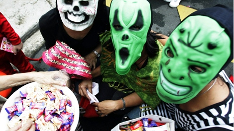 For kids, Halloween fun means not staying in, but dressing up and venturing out on a door-to-door hunt for goodies, sometimes in the cold. (Bullit Marquez / THE CANADIAN PRESS)