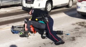 A cell phone video captured a Barrie police officer holding a man to the ground during an arrest on Dunlop Street on Thurs., Feb. 4, 2021