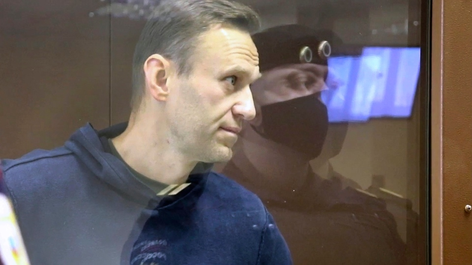 In this image made from video provided by the Babuskinsky District Court, Russian opposition leader Alexei Navalny stands in a cage during a hearing on his charges for defamation, in the Babuskinsky District Court in Moscow, Russia, Friday, Feb. 5, 2021. (Babuskinsky District Court via AP)