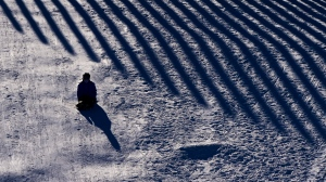 A youngster slides on a slope at Lansdowne Park in Ottawa on Thursday, Feb. 4, 2021. (Sean Kilpatrick/THE CANADIAN PRESS)