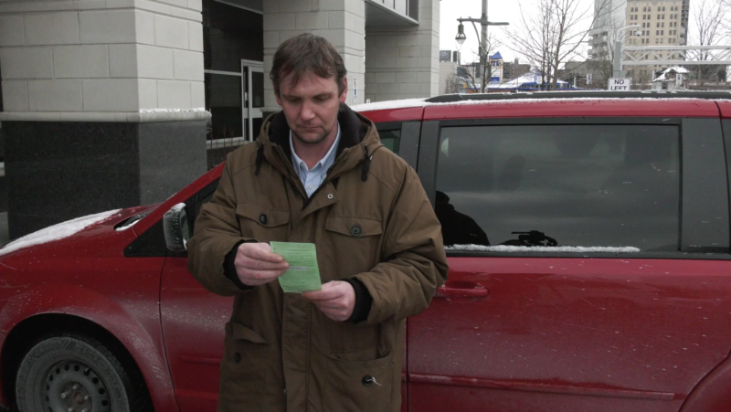 Matthew Steeves looks at his $880 ticket in Leamington, Ont., on Friday, Feb. 5, 2021. (Stefanie Masotti / CTV Windsor)