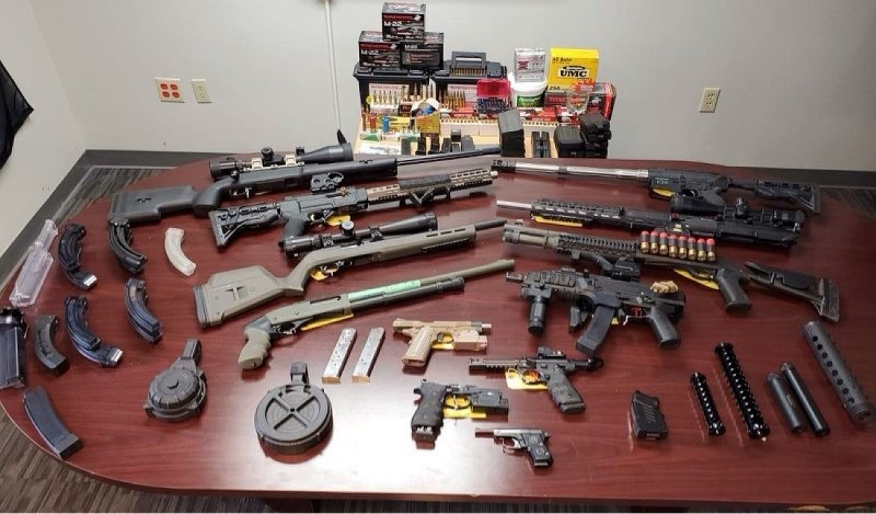 Manitoulin Ontario Provincial Police have seized more than a dozen weapons, including handguns, a submachine gun and semi-automatic rifles, following a month-long investigation of a Sables-Spanish Rivers Township man.