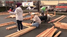 Volunteers construct plant beds for a new community garden in Vancouver's Downtown Eastside. Oct. 31, 2009.