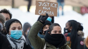 People take part in a protest to denounce police abuses and in support of Mamadi Fara Camara and his family on Friday, February 5, 2021 in Montreal. Camara was released after being arrested and detained for six days after being accused in an assault on a police officer last week. THE CANADIAN PRESS/Ryan Remiorz