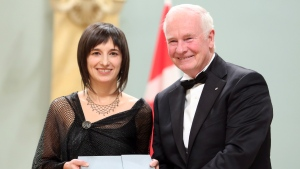 Elise Gravel, of Montreal, receives the Governor General's Literary Award for book illustration from Governor General David Johnston at Rideau Hall in Ottawa Wednesday November 28, 2012. THE CANADIAN PRESS/Fred Chartrand