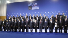 NATO ministers and their ambassadors stand during a group photo of NATO defense ministers in Bratislava, Friday Oct. 23, 2009. (AP / Virginia Mayo)